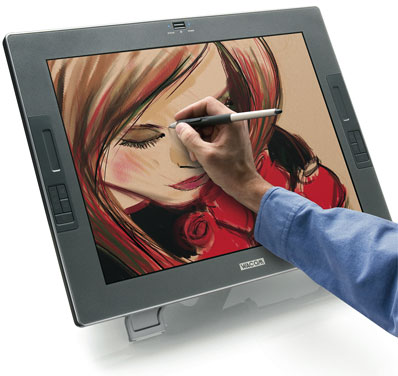 "A Wacom Cintiq 21UX. This is a 21"", 3:2 aspect ratio monitor where you draw right on the screen with the Wacom Pen. It has four buttons and a touch slider on each side. On screen is a digital painting of a red-haired woman smelling roses. An arm and hand holding the pen up is in front of the screen."